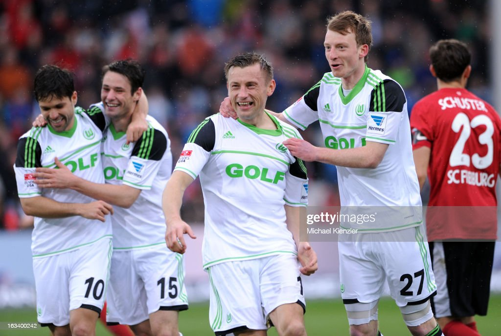 Diego, Christian Traesch, Ivica Olic and Maximilian Arnold of Wolfsburg celebrate Olic's goal to 4:1 during the Bundesliga match between SC Freiburg and VfL Wolfsburg at MAGE SOLAR Stadium on March 9, 2013 in Freiburg, Germany.