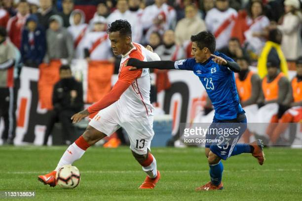 Diego Coco defends against Renato Tapia during an international friendly match between Peru and El Salvador on March 26 at RFK Stadium, in Washington...