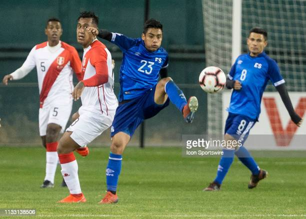 Diego Coco pushes the ball away from Renato Tapia during an international friendly match between Peru and El Salvador on March 26 at RFK Stadium, in...