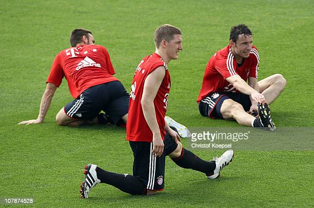 Diego Contento Bastian Schweinsteiger and Mark van Bommel of Bayern stretch during the FC Bayern Muenchen training session at Aspire Academy for...