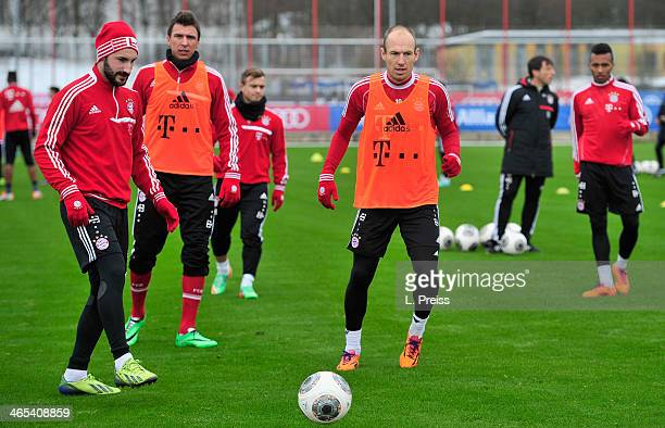 Diego Contento Mario Mandzukic Xherdan Shaqiri and Arjen Robben of Muenchen in action during a training session of FC Bayern Muenchen on January 27...
