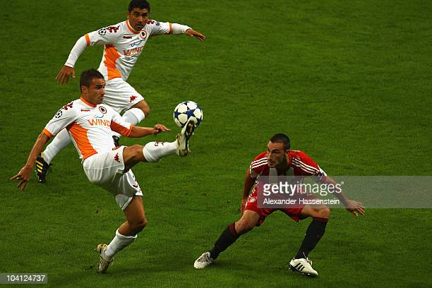 Diego Contento of Bayern Muenchen battles for the ball with Matteo Brighi of Roma during the UEFA Champions League group E match between FC Bayern...