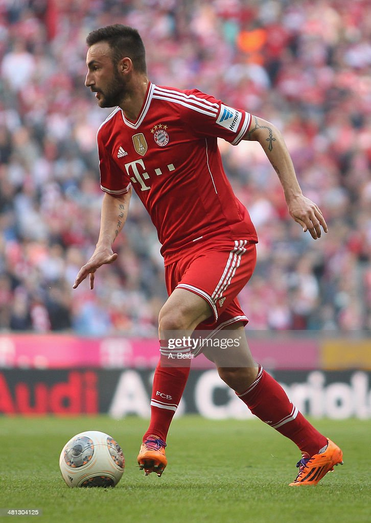 Diego Contento of Bayern Muenchen kicks the ball during the Bundesliga match between FC Bayern Muenchen and 1899 Hoffenheim at Allianz Arena on March 29, 2014 in Munich, Germany.