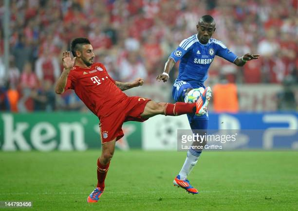 Diego Contento of FC Bayern Muenchen and Salomon Kalou of Chelsea fight for the ball during UEFA Champions League Final between FC Bayern Muenchen...