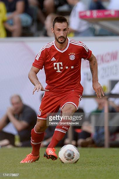 Diego Contento of FC Bayern Muenchen controls the ball during the Telekom 2013 Cup final between FC Bayern Muenchen and Borussia Moenchengladbach on...