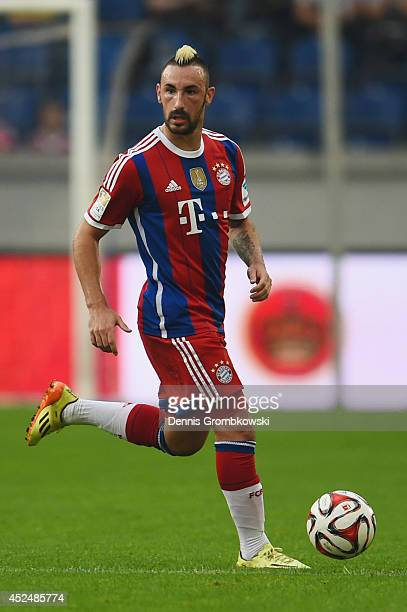 Diego Contento of FC Bayern Muenchen controls the ball during the Friendly Match between MSV Duisburg and FC Bayern Muenchen at SchauInsLandArena on...