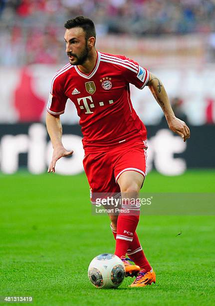 Diego Contento of Muenchen in action during the Bundesliga match between FC Bayern Muenchen and 1899 Hoffenheim at Allianz Arena on March 29 2014 in...