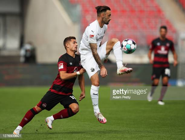 Diego Contento of SV Sandhausen is challenged by Nikola Dovedan of 1. FC Nuernberg the Second Bundesliga match between 1. FC Nürnberg and SV...