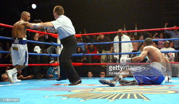 Diego Corrales hits the canvas from a left hook of Joel Casamayor during their bout at Foxwoods Casino Corrales captured the Junior Lightweight title...