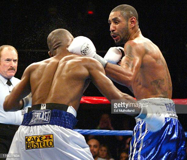 Diego Corrales lands a left hook to the head of Joel Casamayor during their bout at Foxwoods Casino Corrales captured the Junior Lightweight title...