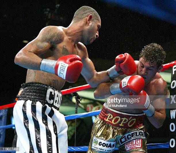 Diego Corrales lands a left to the head of Acelino Freitas during their WBO Lightweight Championship bout at Foxwoods Casino Corrales won the title...
