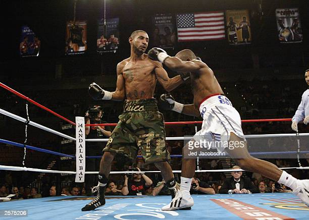 Diego Corrales lands a lefthand punch to the head of Joel Casamayor in an IBF Junior Lightweight title elimination bout on October 4 2003 at the...