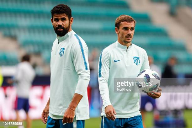 Diego Costa and Antoine Griezmann of Atletico Madrid during an Atletico Madrid training session ahead of the UEFA Super Cup match against Real Madrid...