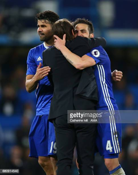 Diego Costa and Cesc Fabregas of Chelsea hug Antonio Conte manager / head coach of Chelsea during the Premier League match between Chelsea and...