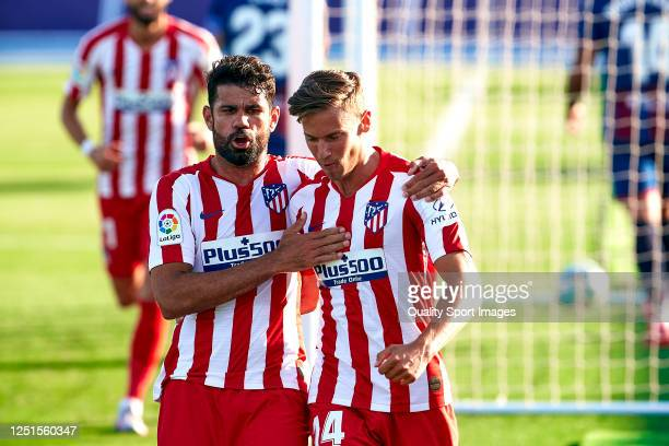 Diego Costa and Marcos Llorente of Club Atletico de Madrid celebrating their team's first goal during the Liga match between Levante UD and Club...