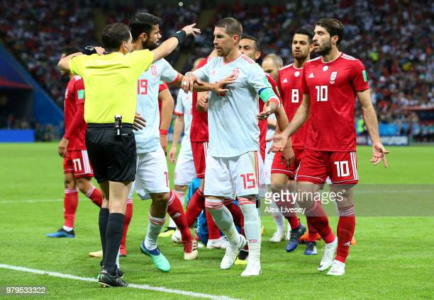 Diego Costa and Sergio Ramos of Spain confront referee Andres Cunha during the 2018 FIFA World Cup Russia group B match between Iran and Spain at...