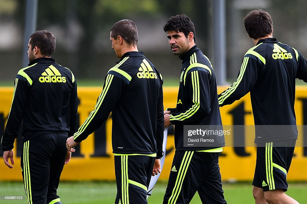 Diego Costa chats with his teammate Fernando Torres of Spain during a Spain training session at Centro de Entrenamiento do Caju on June 21, 2014 in Curitiba, Brazil.