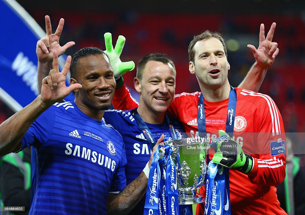 Diego Costa, John Terry and Petr Cech of Chelsea pose with the trophy after the Capital One Cup Final match between Chelsea and Tottenham Hotspur at Wembley Stadium on March 1, 2015 in London, England.