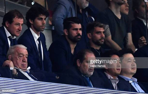 Diego Costa looks on from the stands during the UEFA Champions League group C match between Atletico Madrid and Chelsea FC at Estadio Wanda...