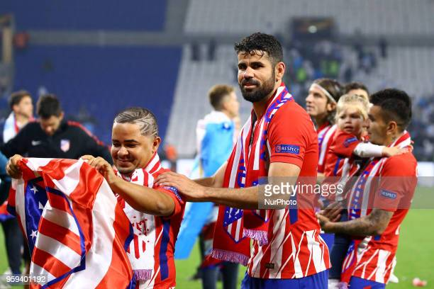 Diego Costa of Atletico celebrates with a friend at Groupama Stadium in Lyon France on May 16 2018 during UEFA Europa League final football match...