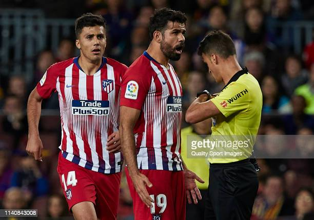 Diego Costa of Atletico de Madrid argues with referee Jesus Gil Manzano during the La Liga match between FC Barcelona and Club Atletico de Madrid at...