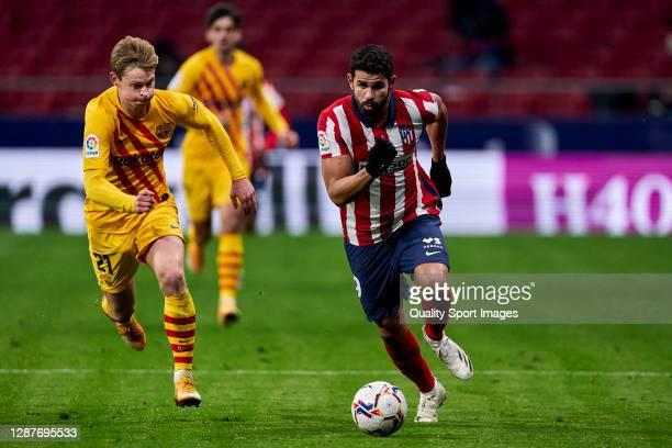 Diego Costa of Atletico de Madrid battle for the ball with Frenkie de Jong of FC Barcelona during the La Liga Santander match between Atletico de...
