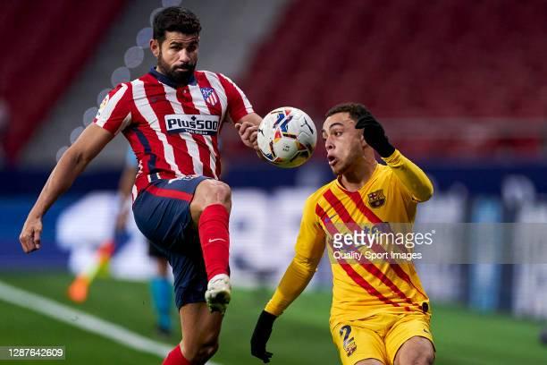 Diego Costa of Atletico de Madrid battle for the ball with Sergiño Dest of FC Barcelona during the La Liga Santander match between Atletico de Madrid...