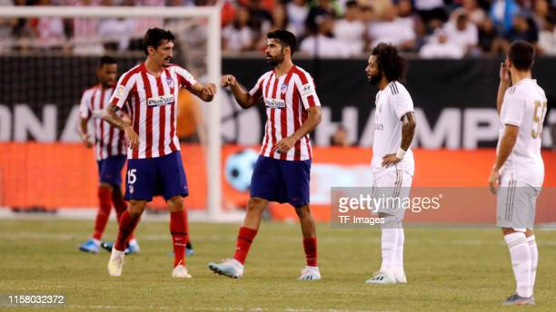 Diego Costa of Atletico de Madrid celebrates his team's sixth goal with team mates during the 2019 International Champions Cup between Real Madrid...