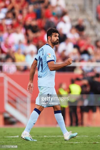 Diego Costa of Atletico de Madrid celebrates scoring the opening goal during the La Liga match between RCD Mallorca and Club Atletico de Madrid at...
