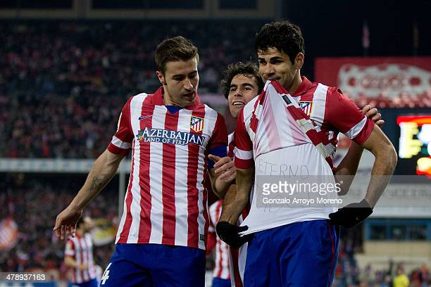 Diego Costa of Atletico de Madrid celebrates scoring their opening goal with teammates Gabi Fernandez and Tiago Mendes during the La Liga match...