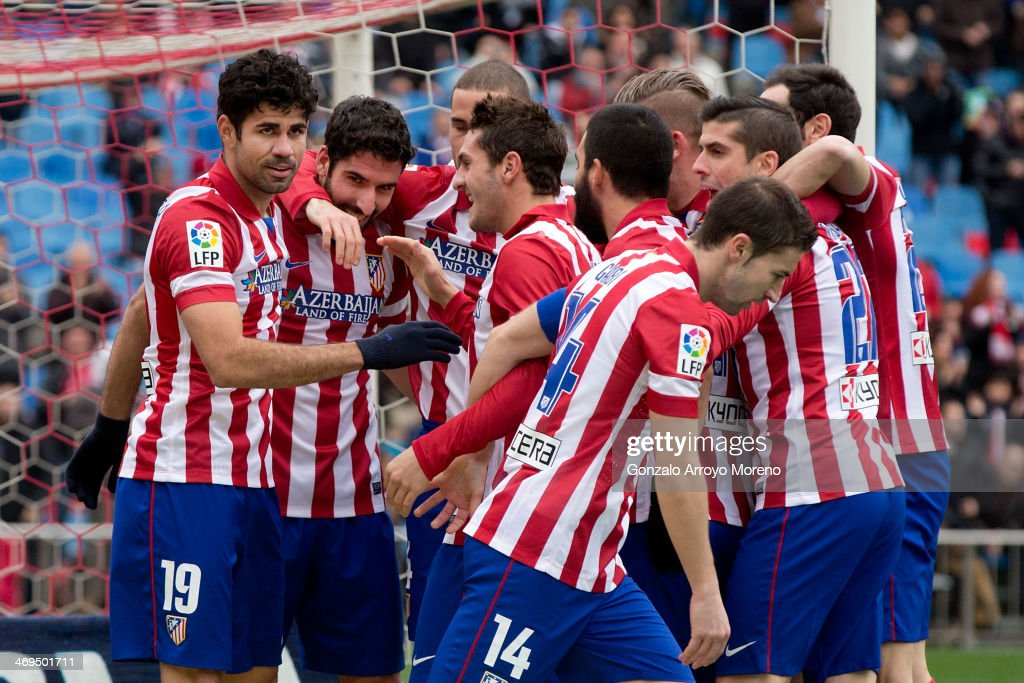 Diego Costa (L) of Atletico de Madrid celebrates scoring their second goal with teammates Raul Garcia (2ndL) and teammates during the La Liga match between Club Atletico de Madrid and Real Valladolid CF at Vicente Calderon Stadium on February 15, 2014 in Madrid, Spain.