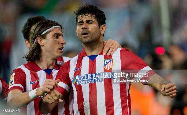 Diego Costa of Atletico de Madrid celebrates scoring their second goal with teammate Filipe Luis during the La Liga match between Club Atletico de...