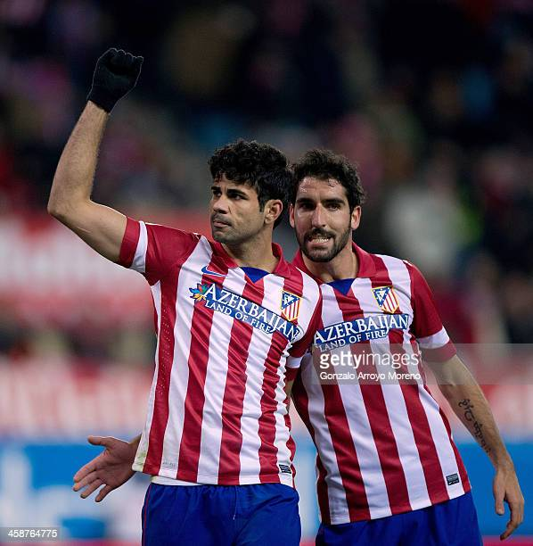 Diego Costa of Atletico de Madrid celebrates scoring their third goal with teammate Raul Garcia during the La Liga match between Club Atletico de...