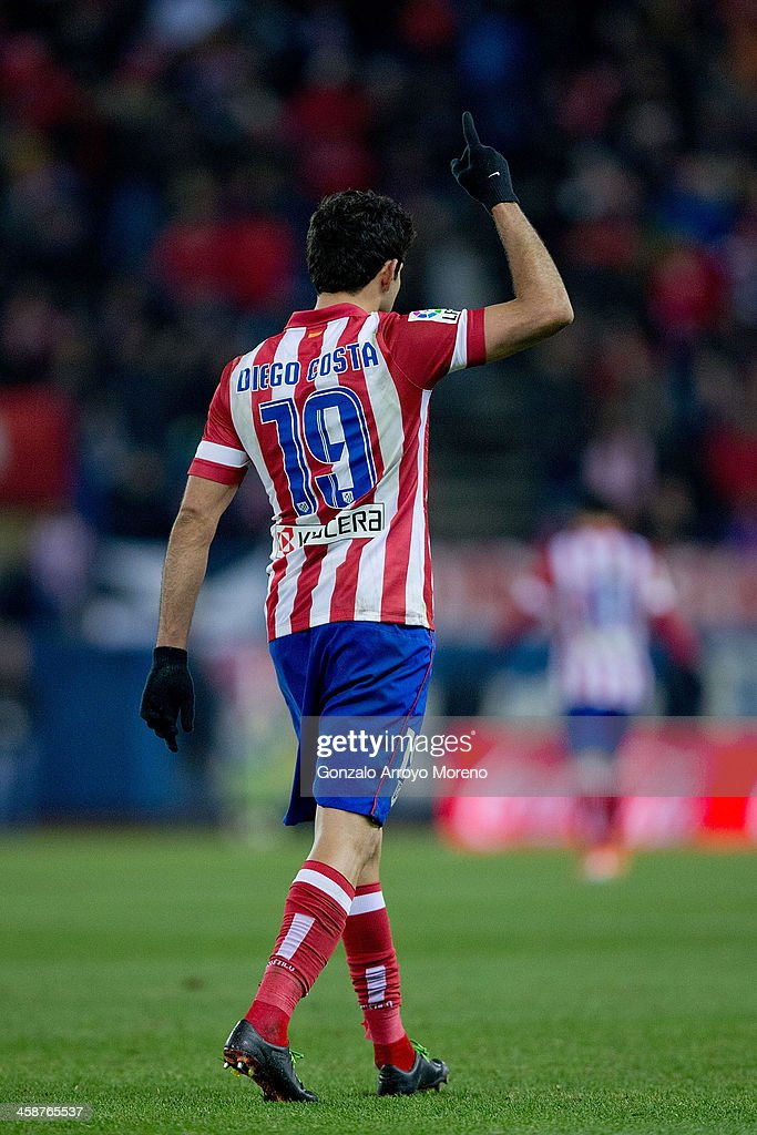 Diego Costa of Atletico de Madrid celebrates scoring their third goal during the La Liga match between Club Atletico de Madrid and Levante UD at Vicente Calderon Stadium on December 21, 2013 in Madrid, Spain.