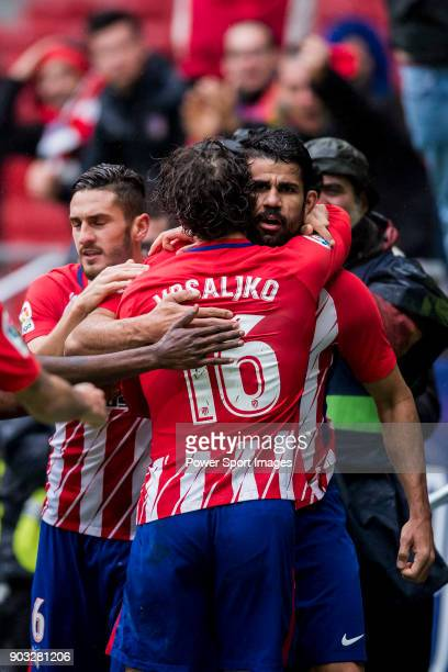 Diego Costa of Atletico de Madrid celebrates with teammate Sime Vrsaljko during the La Liga 201718 match between Atletico de Madrid and Getafe CF at...