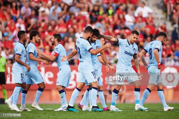 Diego Costa of Atletico de Madrid celebrates with teammates after scoring the opening goal during the La Liga match between RCD Mallorca and Club...