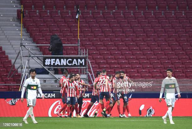 Diego Costa of Atletico de Madrid celebrates with teammates after scoring their team's third goal from the penalty spot during the La Liga Santander...