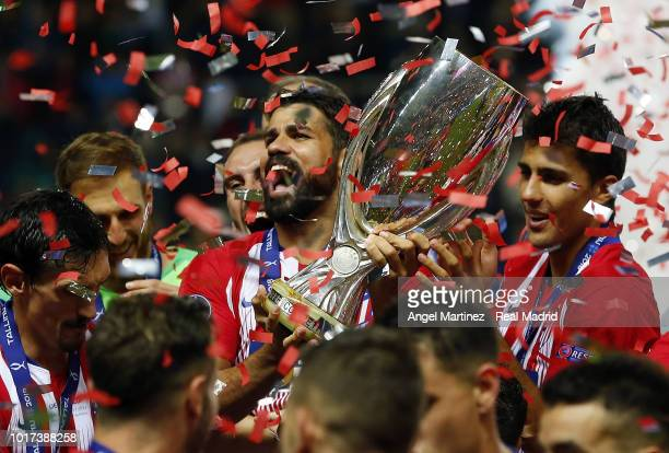 Diego Costa of Atletico de Madrid celebrates with the trophy after the UEFA Super Cup match between Real Madrid and Atletico de Madrid at A Le Coq...