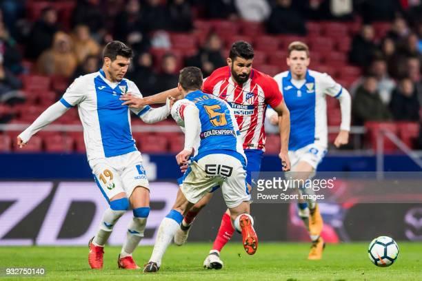 Diego Costa of Atletico de Madrid competes for the ball with Ezequiel Matias Munoz and Martin Maximiliano Mantovani of CD Leganes during the La Liga...