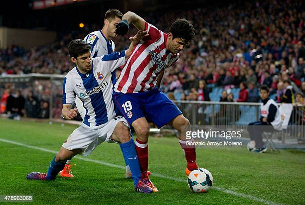 Diego Costa of Atletico de Madrid competes for the ball with Javier Lopez of RCD Espanyol during the La Liga match between Club Atletico de Madrid...