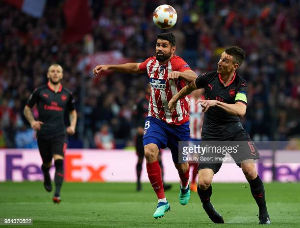 Diego Costa of Atletico de Madrid competes for the ball with Laurent Koscielny of Arsenal during the UEFA Europa League Semi Final second leg match...