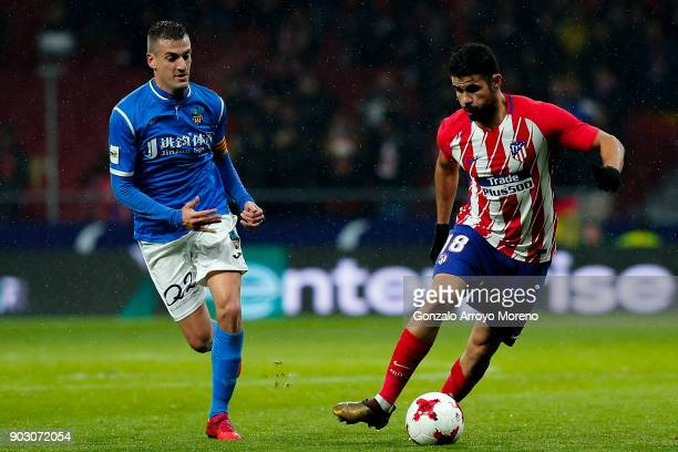 Diego Costa of Atletico de Madrid competes for the ball with Marc Nierga of Lleida Esportiu during the Copa del Rey second leg match between Club...