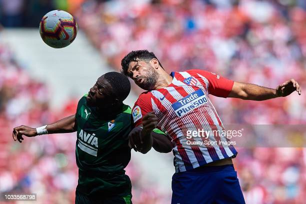 Diego Costa of Atletico de Madrid competes for the ball with Pape Diop of SD Eibar during the La Liga match between Club Atletico de Madrid and SD...