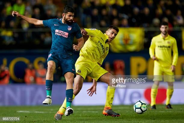 Diego Costa of Atletico de Madrid competes for the ball with Rodrigo of Villarreal CF during the La Liga match between Villarreal CF and Atletico de...