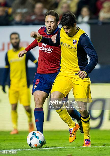 Diego Costa of Atletico de Madrid duels for the ball with Manuel Jesus Ortiz 'Lolo' of CA Osasuna during the La Liga match between CA Osasuna and...