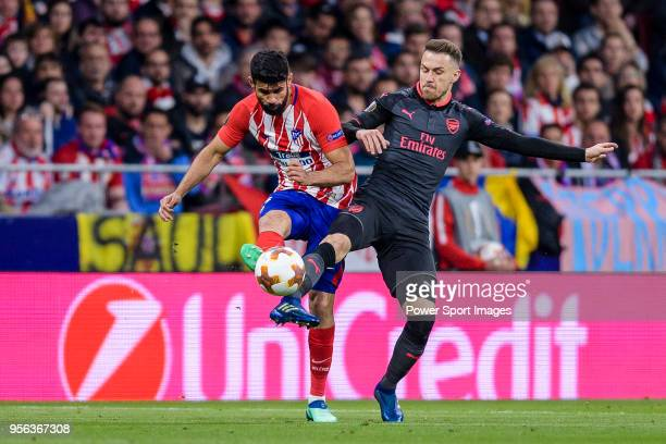 Diego Costa of Atletico de Madrid fights for the ball with Aaron Ramsey of Arsenal FC during the UEFA Europa League 201718 semifinals match between...
