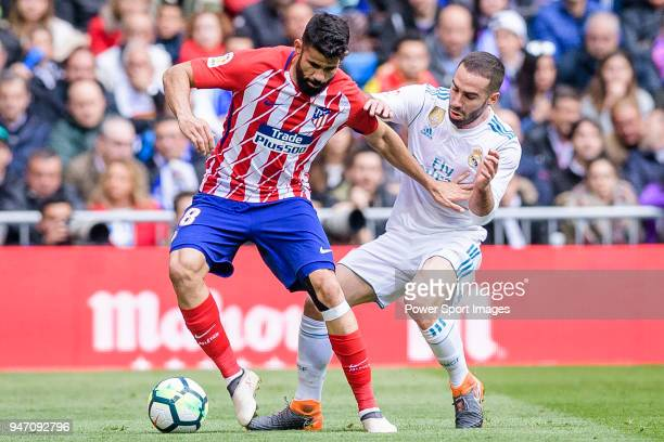 Diego Costa of Atletico de Madrid fights for the ball with Daniel Carvajal Ramos of Real Madrid during the La Liga match between Real Madrid and...