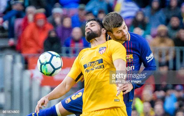 Diego Costa of Atletico de Madrid fights for the ball with Gerard Pique Bernabeu of FC Barcelona during the La Liga 201718 match at Camp Nou between...