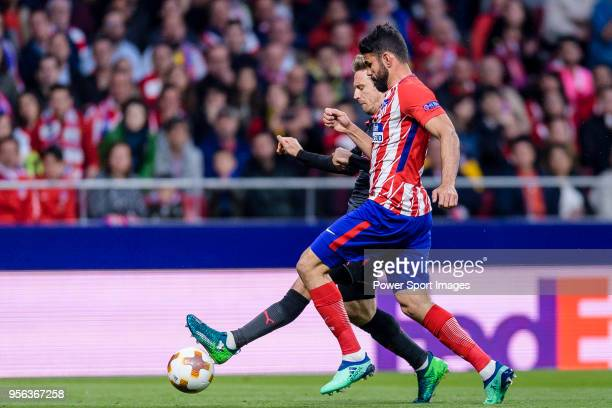 Diego Costa of Atletico de Madrid fights for the ball with Nacho Monreal of Arsenal FC during the UEFA Europa League 201718 semifinals match between...