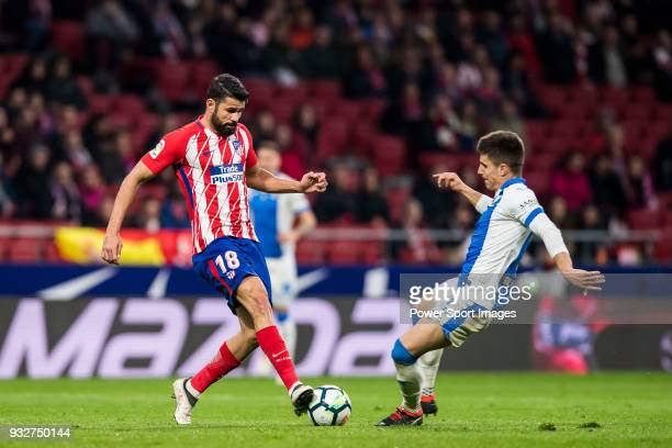 Diego Costa of Atletico de Madrid fights for the ball with Unai Bustinza Bustinza M of CD Leganes during the La Liga 201718 match between Atletico de...